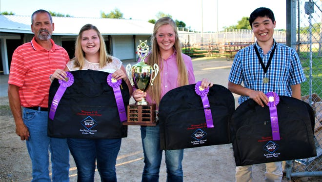 Earning first place in the senior division at the State 4-H Livestock Judging contest held July 24 in Lodi was the Manitowoc team (from left) coach Rob Ash, Megan Greif, Vanessa Roberts and Ambrose Wiering.