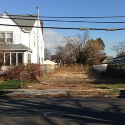 A lot stands empty in West Hempstead, N.Y., after the township had the home that once stood on it torn down. Homeowner Philip Williams says he went to Fort Lauderdale for a knee replacement in December 2014. When he returned, his home was gone.