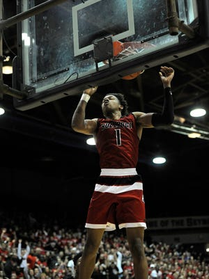 New Albany's Romeo Langford (1) dunks against Castle on Saturday in the 2017 IHSAA 4A Regional Basketball Final at Seymour High School. Langford scored 44 points but Castle won 72-64. (Photo by David Lee Hartlage, Special to The Courier-Journal) Mar. 11, 2017