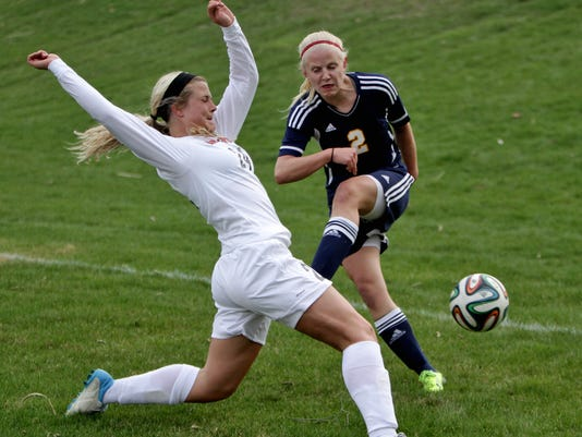 Brightons Holly Hermans uses her body to block a shot on goal by Hartlands M.jpg