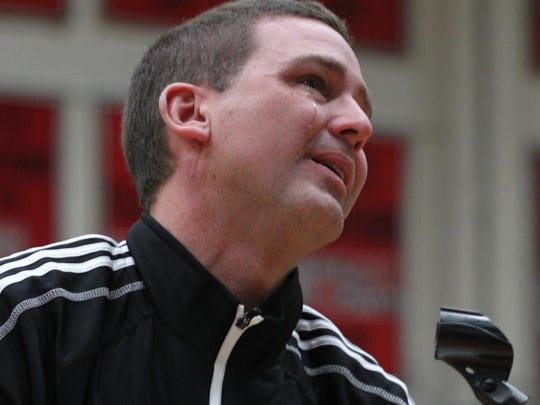 Tears stream down the face of SPASH coach Scott Anderson as he talks with the crowd at SPASH, Sunday, March 22, 2015, about his team winning the WIAA Division 1 boys' state basketball championship.