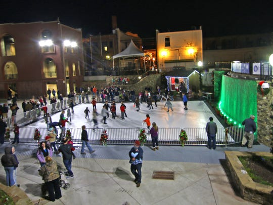 Families skate at the outdoor rink in Wren Park in downtown Anderson.