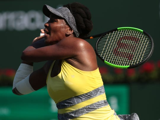 American Venus Williams returns the ball to Shuai Peng, of China, at the BNP Paribas Open women's 4th round on Tuesday, March 14, 2017 in Indian Wells, CA.