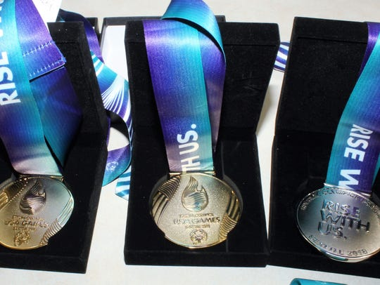 Swimmer Michael Lehrer wins gold medals for Old Bridge