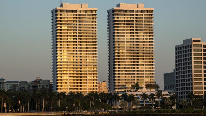 The twin towers on Flagler Drive in downtown West Palm Beach, which no longer have the Trump Plaza sign atop the buildings Thursday, April 11, 2019.