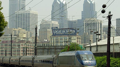 FILE - An Amtrak train pulls out of Philadelphia on its way to Washington, Tuesday, June 25, 2002. Authorities say an Amtrak train struck a piece of construction equipment just south of Philadelphia on Sunday, April 3, 2016.