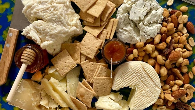 U.S. football fans will consume enough cheese during the big game to turn every NFL playing field into a giant cheese board.