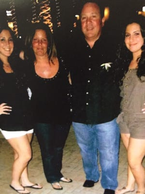 Ralph Politi Jr. with his wife, Rosemarie, and their twin daughters prior to his death in 2012.