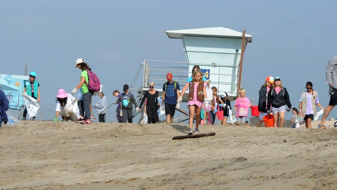 Volunteers help collect trash at Mugu Rock during last year's Coastal Cleanup Day.