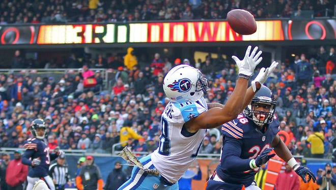 Titans wide receiver Rishard Matthews (18) catches a 29-yard touchdown pass over Chicago Bears free safety Adrian Amos (38) during the second quarter at Soldier Field.