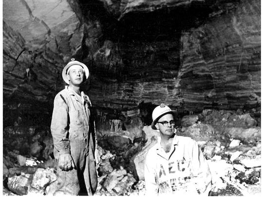 Dale Sedgwick (right) and an unknown newspaper man stand underground inside the cavity created by the Gnome Project atomic blast. The garments they were wearing were considered protective clothing when the photo was taken in 1962.