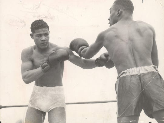 Joe Louis boxes unknown opponent Aug. 17, 1935, in an exhibition match at the State Fair Grounds in Detroit.