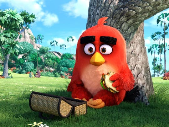 """Red (Jason Sudeikis) enjoys lunch alone in the park in """"Angry Birds."""""""
