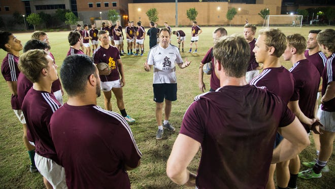 ASU rugby coach Gary Lane talks with his team during practice earlier this season.