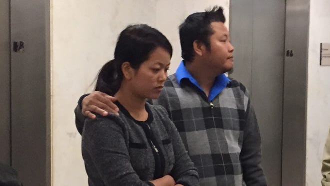 Khin Par Thaing and a man believed to be her husband leave court after she pleaded guilty to battery Friday. Oct. 28, 2016.