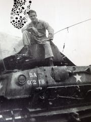 Henry Corsi, a 91-year-old Valhalla Army veteran is pictured atop a M36 tank while in the Army  during World War II. He attended the Nuremberg trials for Nazi war criminals in Germany.