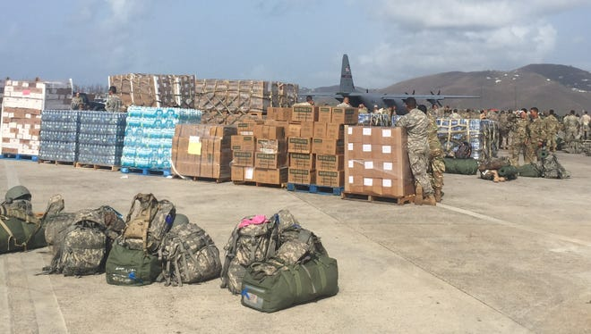U.S. military personnel move food onto the tarmac in St. Thomas, U.S. Virgin Islands as part of recovery efforts following Hurricane Irma and Hurricane Maria.