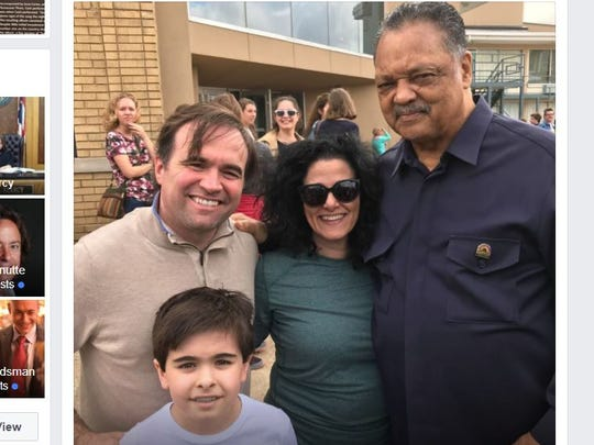 Rev. Jesse Jackson, right, posed for a photo with Cincinnati