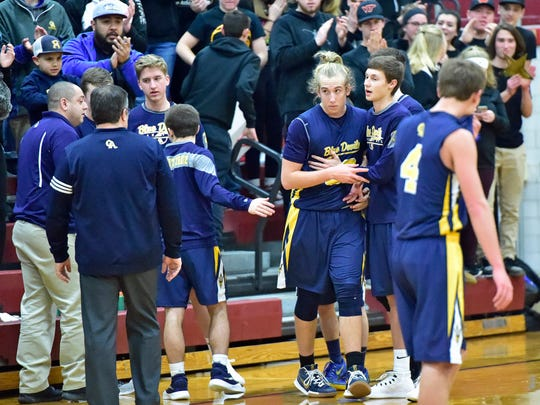 Teammates applaud Greencastle's Bryan Gembe's 1000 career point. Shippensburg took on Greencastle, Tuesday, January 30, 2018. The Blue Devil's won 59-58.