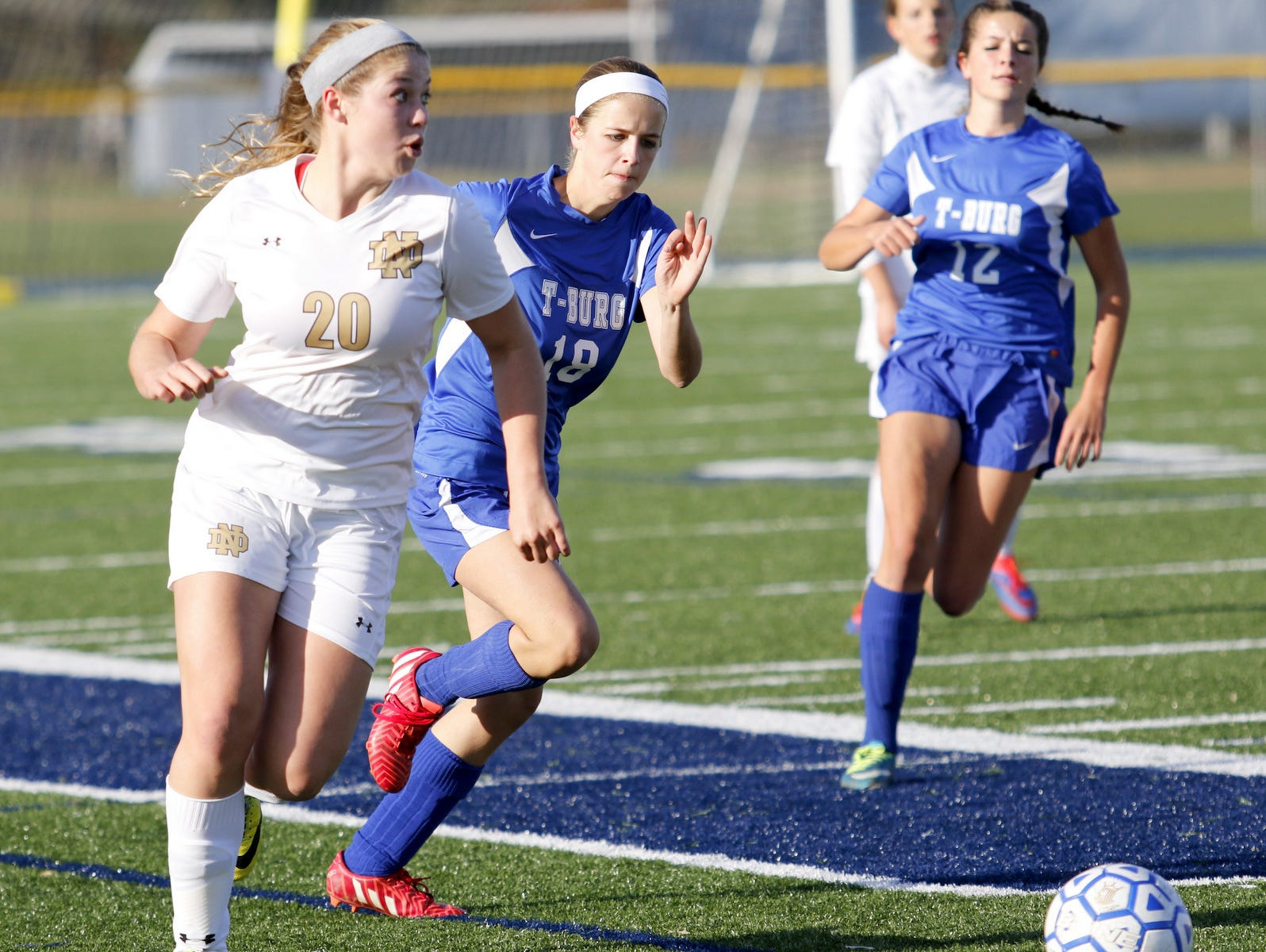 Notre Dame's Mia Herlan dribbles with the ball as two Trumansburg's Cassie Proctor, center, and Kelly Proctor, back, give chase Tuesday during a Section 4 Class C girls soccer semifinal at Brewer Memorial Stadium.