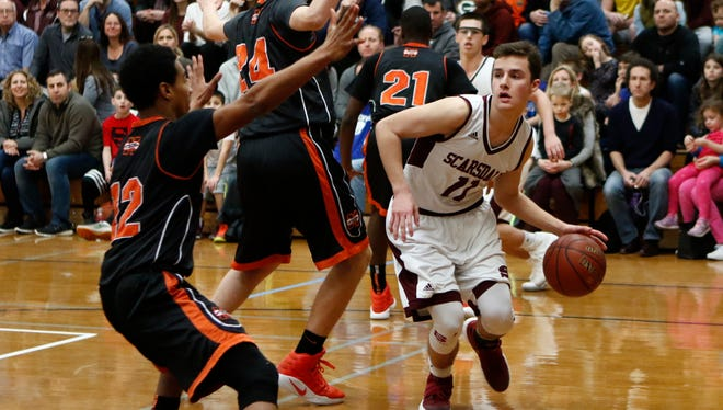 Scarsdale's Max Bosco (11) looks for a pas at the base-line during their 61-58 win over Mamaroneck in the class AA playoff basketball game at Scarsdale High School on Saturday, February 18, 2017.