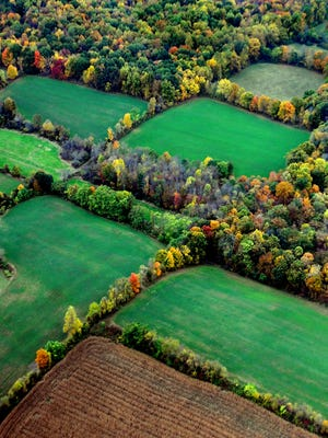In this aerial photograph, scenic farm land is viewed looking southwest in central Dutchess County. 10/2014