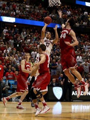 Arizona's Nick Johnson is called for an offensive foul late in the game.