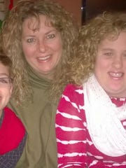 Maggie Branch (right) with her mom and brother during
