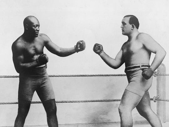 American boxers Jack Johnson (left) and James Jeffries