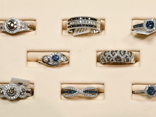 An assortment of colored diamond rings at Bachman Jewelers Wednesday, Oct. 12, in St. Cloud.