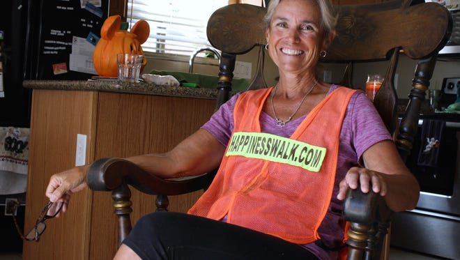 Paula Francis is taken in by Phoenix resident Brianna James after inspiring James with the stories of her Happiness Walk. Francis  poses for a photo in the home of Brianna James a day before she hits the halfway point on her trek around the U.S. on Oct 22, 2016 in Phoenix, Ariz.
