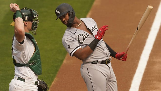 Chicago White Sox's Eloy Jimenez, right, stands in the batters box in front of Oakland Athletics catcher Sean Murphy during Game 3 of an American League wild card series last week in Oakland, Calif.