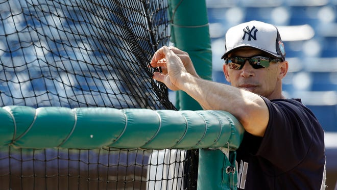 New York Yankees manager Joe Girardi watches batting practice before a spring training baseball game against the Washington Nationals, Wednesday, March 23, 2016, in Viera, Fla.