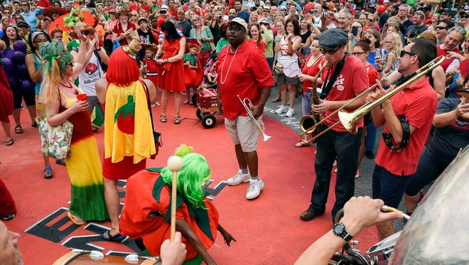 The band Half Brass plays some New Orleans style zydeco music at Five Points during the 13th annual Tomato Art Festival kicks off in East Nashville on August 13, 2016.