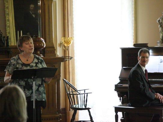 Joan Eckermann sings soprano and Dennis Pita accompanies