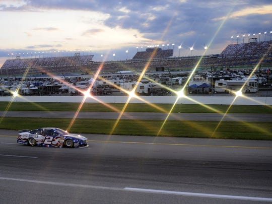 Brad Keselowski (2) races into turn three during the Quaker State 400 at Kentucky Speedway.