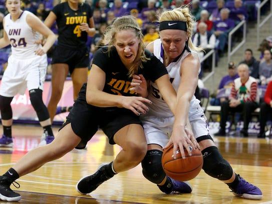 Northern Iowa's Megan Maahs battles for a loose ball
