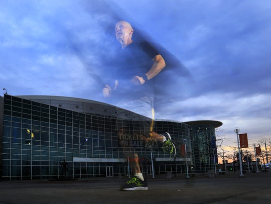 Terry Charles, corporate communications manager for PMI Entertainment Group, gets in an early-morning run outside the Resch Center on May 9. An avid runner, he's one of only 40 people who has completed either the half marathon or marathon every year since the Cellcom Green Bay Marathon started in 2000.