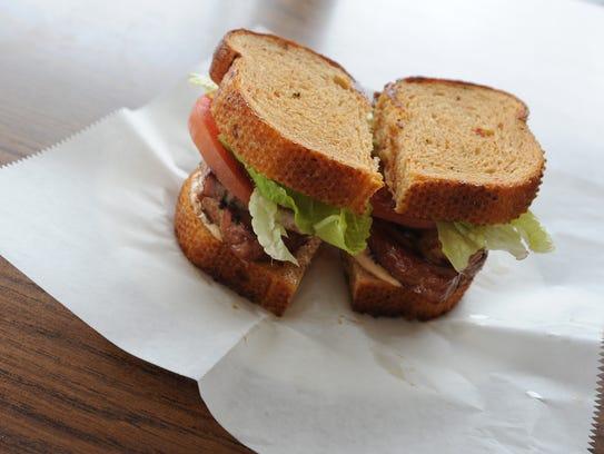 7 Miles Smokehouse serves sandwiches, like this smoked