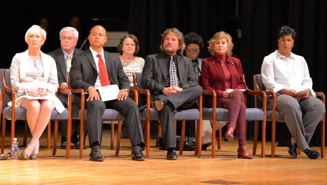 The five members of the Sussex Central High School Hall of Fame Class of 2015 sit on the stage in front of supporters at an induction ceremony Friday, Nov. 20 at the school.