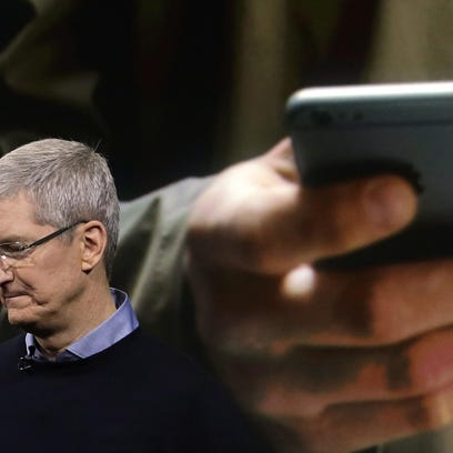 Apple CEO Tim Cook speaks at a March product unveiling at company headquarters in Cupertino, Calif. Apple and other tech companies are pushing back against the surveillance state in the nation's courts.