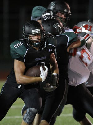 Yorktown's Timothy Forbes (3) finds some running room. The Huskers are favored in Class A. They have seen some key players hobbled by injuries, but their size and depth are part of what set them apart.