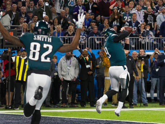 Eagles quarterback Nick Foles comes down with a touchdown