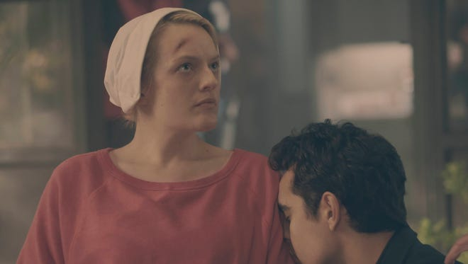 Offred (Elisabeth Moss) and Nick (Max Minghella) in 'The Handmaid's Tale.'