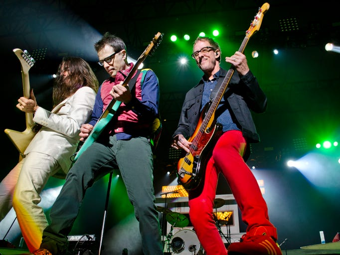 Brian Bell, Rivers Cuomo and Scott Shriner of Weezer