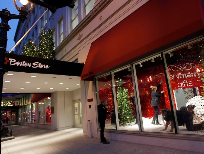 Boston Store's visual merchandising team prepares a