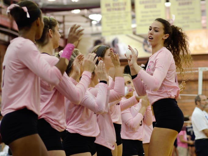 Taryn Knuth (13) and the Florida State Women's Volleyball