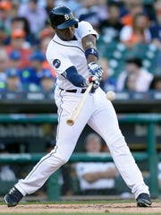 Tigers leftfielder Justin Upton doubles during the