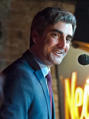 Mayor Miro Weinberger greets supporters at Nectar's in Burlington Tuesday night after his landslide victory.