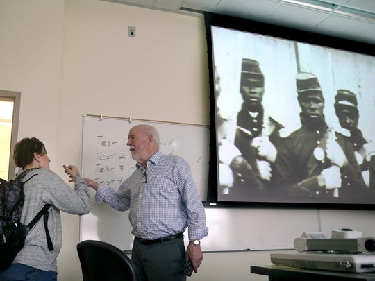 Olympic College history professor Phil Schaffer is retiring after 50 years at the college. He is going over the final testing schedule with a student on his last day of teaching. He was giving instruction about the American Civil War.